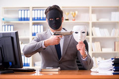 The businessman with mask in office hypocrisy concept. Businessman with mask in office hypocrisy concept Royalty Free Stock Photography