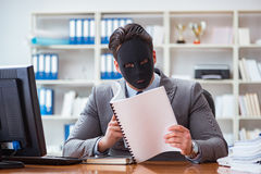 The businessman with mask in office hypocrisy concept. Businessman with mask in office hypocrisy concept Royalty Free Stock Image
