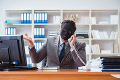 The businessman with mask in office hypocrisy concept. Businessman with mask in office hypocrisy concept Stock Image