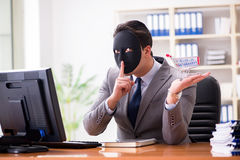 The businessman with mask in office hypocrisy concept. Businessman with mask in office hypocrisy concept Stock Images