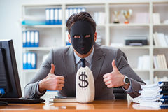 The businessman with mask in office hypocrisy concept Stock Photography