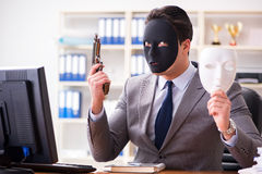 The businessman with mask in office hypocrisy concept Royalty Free Stock Photo