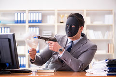 The businessman with mask in office hypocrisy concept. Businessman with mask in office hypocrisy concept Royalty Free Stock Photos