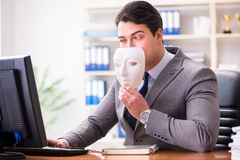 The businessman with mask in office hypocrisy concept Stock Images