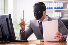 The businessman with mask in office hypocrisy concept. Businessman with mask in office hypocrisy concept Royalty Free Stock Photo