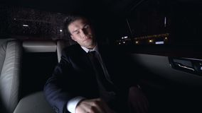 Businessman massaging temples in car on way home, strong headache, stressful job stock footage