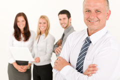 Businessman mature with colleagues stand in back Royalty Free Stock Photos
