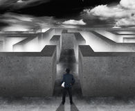 Businessman with maze, business concept of decision making. Businessman standing in front of maze, business concept of decision making Stock Image