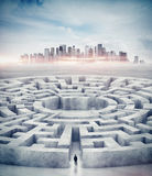 Businessman in maze and city on horizon. 3d stock photography
