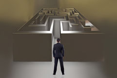 The businessman with maze in difficult situations concept Royalty Free Stock Images