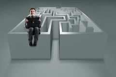 The businessman with maze in difficult situations concept Royalty Free Stock Photos