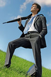 Businessman at the meadow Stock Images