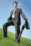 Businessman at the meadow Stock Photo