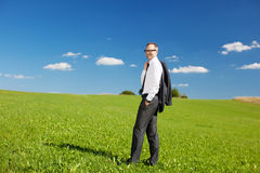 Businessman in meadow Stock Images