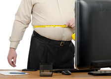Businessman measures big waist by tape meter Stock Photography