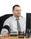 Businessman measures blood pressure in front of monitor Royalty Free Stock Photos