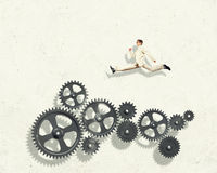 Businessman and mechanism elements Stock Photography