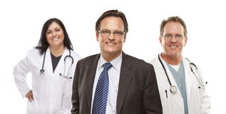 Businessman with Medical Personnel Behind royalty free stock photo