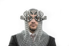 Businessman with medieval executioner in metal and silver glasse Stock Image