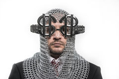 Businessman with medieval executioner in metal and silver glasse Stock Photo