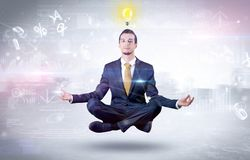 Businessman meditates with enlightenment concept. Businessman meditates with enlightenment data reports and financial concept stock images