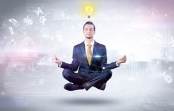 Businessman meditates with enlightenment concept. Businessman meditates with enlightenment data reports and financial concept stock photography