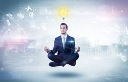 Businessman meditates with enlightenment concept. Businessman meditates with enlightenment data reports and financial conceptn stock photo
