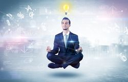 Businessman meditates with enlightenment concept. Businessman meditates with enlightenment data reports and financial concept royalty free stock photos