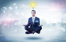 Businessman meditates with enlightenment concept. Businessman meditates with enlightenment data reports and financial concept royalty free illustration