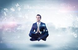 Businessman meditates with enlightenment concept. Businessman meditates with enlightenment data reports and financial concept royalty free stock photo