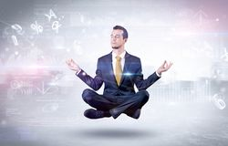 Businessman meditates with enlightenment concept. Businessman meditates with enlightenment data reports and financial concept stock photo