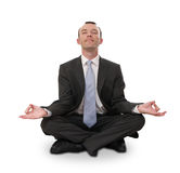 Businessman meditating. Relaxed businessman meditating isolated on white Stock Photo