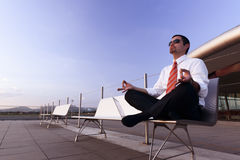 Businessman meditating. Royalty Free Stock Photos