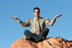 Businessman meditating Royalty Free Stock Photo