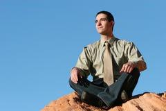 Businessman meditating royalty free stock images