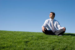 Businessman meditating Stock Image