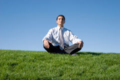 Businessman meditating Stock Photo