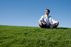 Businessman meditating Royalty Free Stock Photos