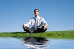 Businessman meditating Stock Photography