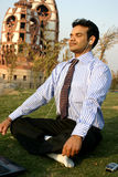 Businessman meditating Stock Photos