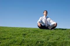 Businessman meditating Stock Photography