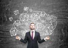 Businessman meditating against dice sketch Royalty Free Stock Image
