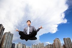 Businessman meditating in the air Stock Photos