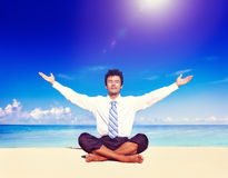 Businessman meditating on the beach Concept Stock Photo
