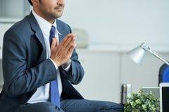 Businessman meditating Stock Images