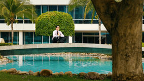 Businessman Meditating Doing Yoga Outside Office Building Royalty Free Stock Photo