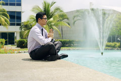 Businessman Meditating Doing Yoga Outside Office Building Royalty Free Stock Photos