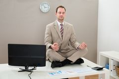 Businessman meditating with eyes closed Royalty Free Stock Photo