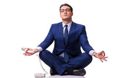 The businessman meditating on the floor isolated on white Stock Images