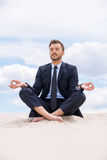 Businessman meditating. Royalty Free Stock Image